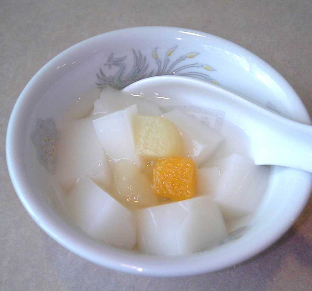 Xingren Donfu look like wet marshmellows, served with fruits and is one of the foods that start with X