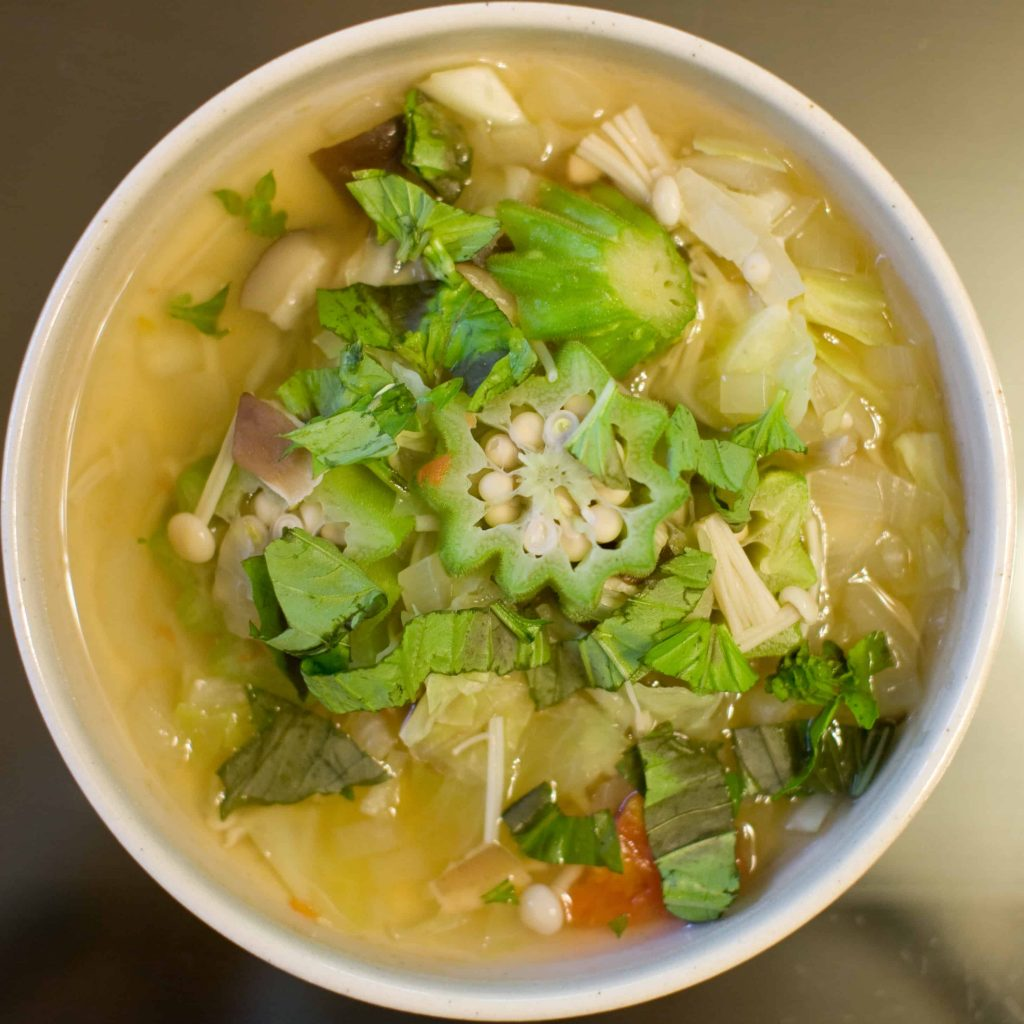 Xidoufen is a soup that is served with  lettuce, spring onions coriander sprinkled on it