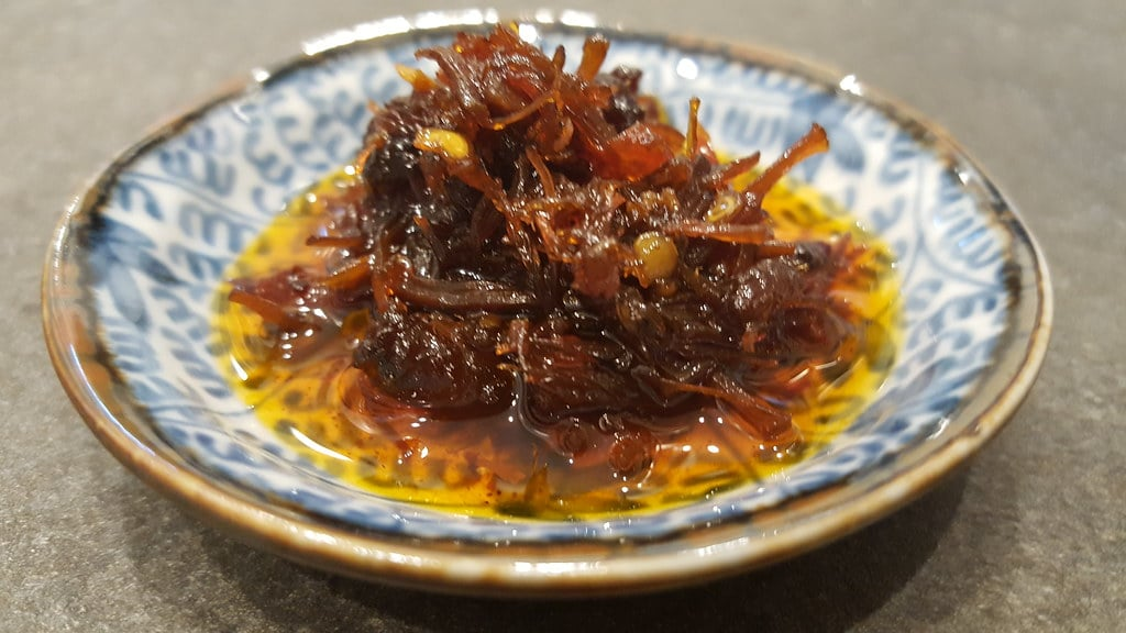 xo sauce has a high consistency and red in color, best served with cured ham,