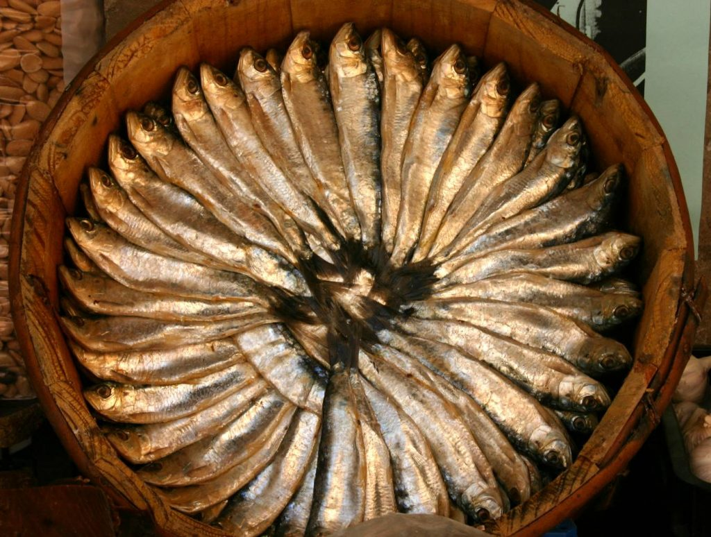 Multiple Xouba fishes sitting on a plate, ready to be cooked