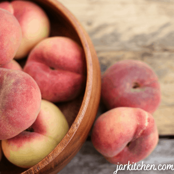 Nectarine has a soft surface and looks like a small peach, but a harder one.